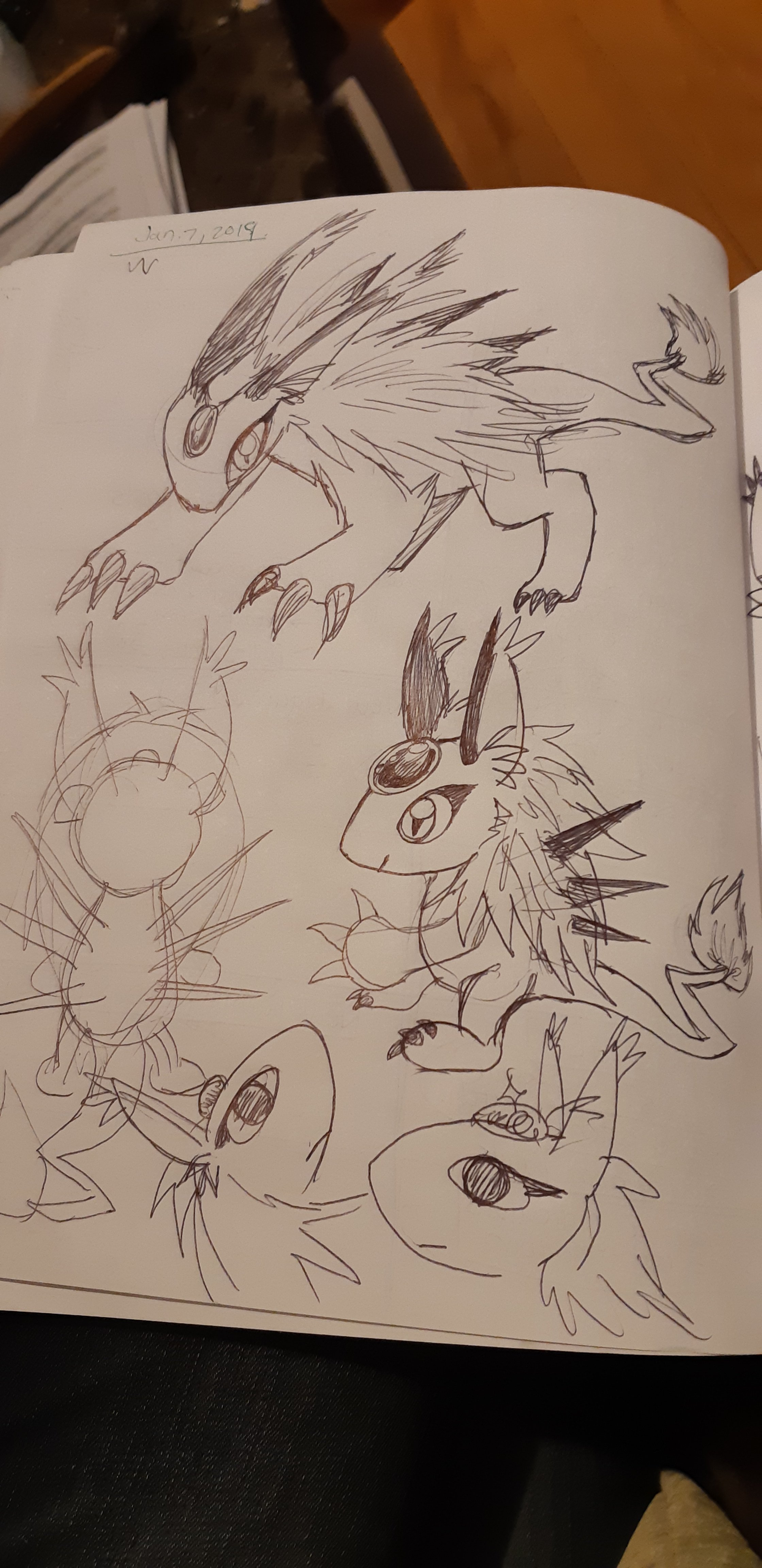 Concept sketches, depicting earlier versions of the zipper dragon. One looks like a rabbit-cat with a jewel on the forehead and long fur on its back.