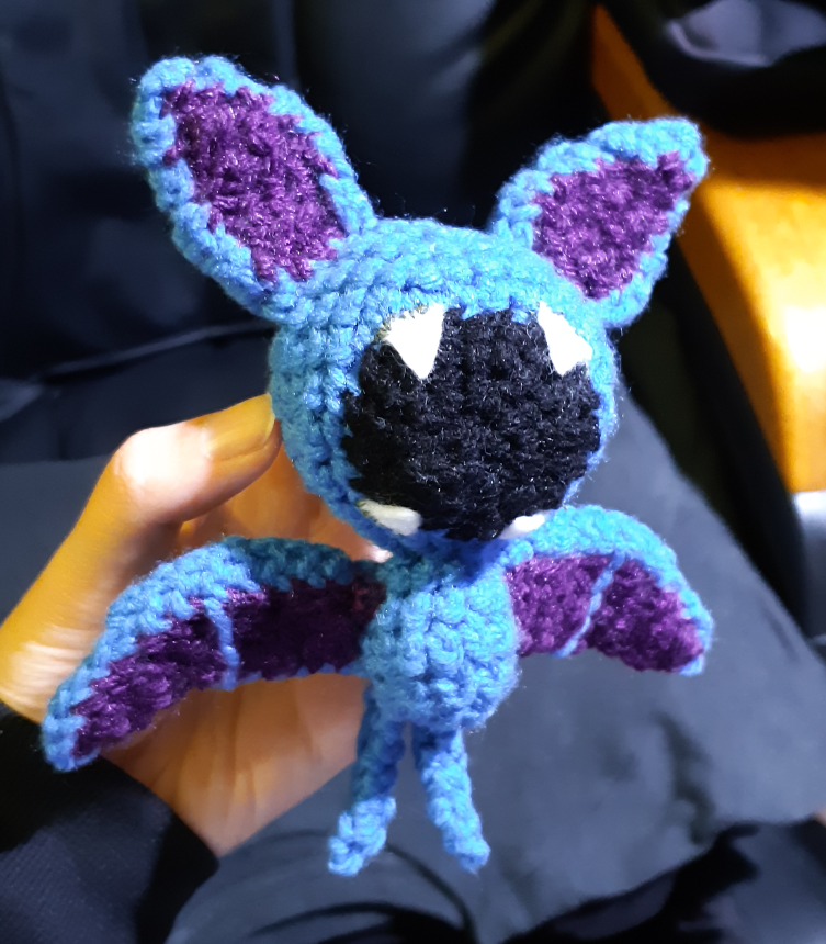 A crocheted version of a Zubat. This is the front view.