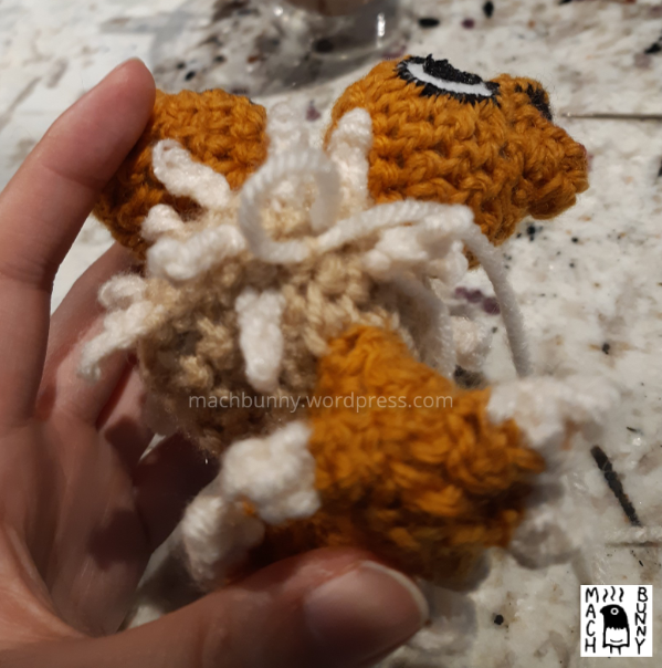 Chiks the Beta Pokemon amigurumi, W.I.P. view of making a new fluff piece, using a loop to begin the process.