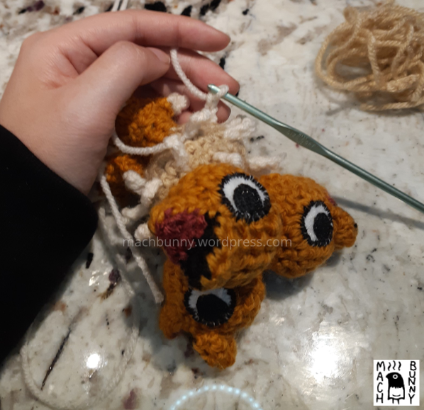 Chiks the Beta Pokemon amigurumi, W.I.P. view of making a new fluff piece, using a crochet hook.