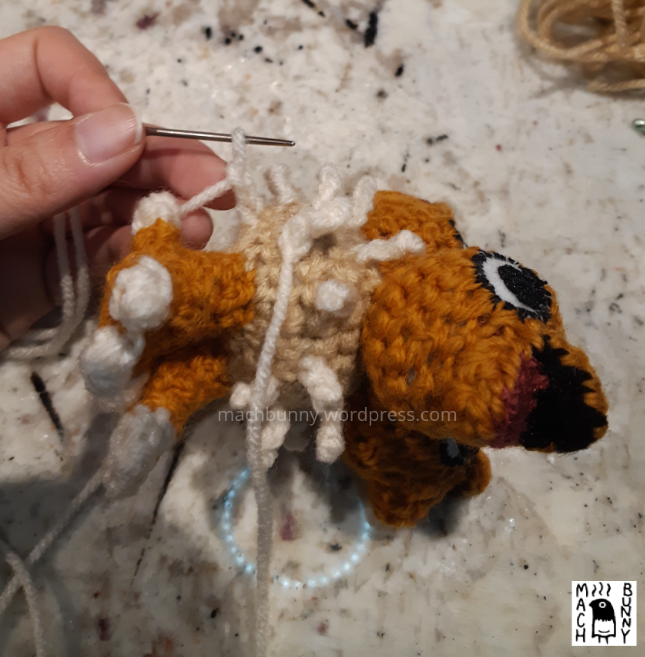 Chiks the Beta Pokemon amigurumi, W.I.P. view of making a new fluff piece, using the knitter's needle.