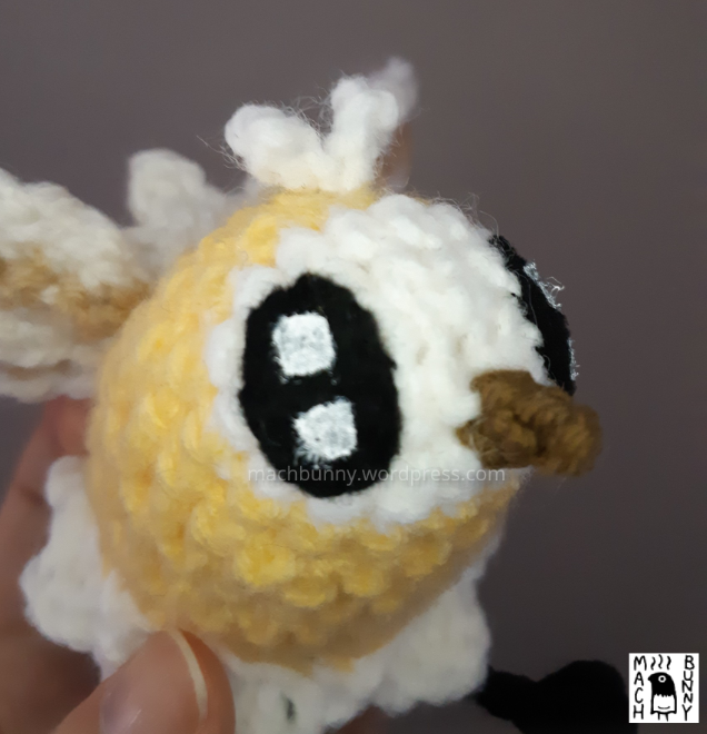 Cutiefly amigurumi - yellow cutiefly amigurumi crocheted with acrylic yarn; closeup of the face