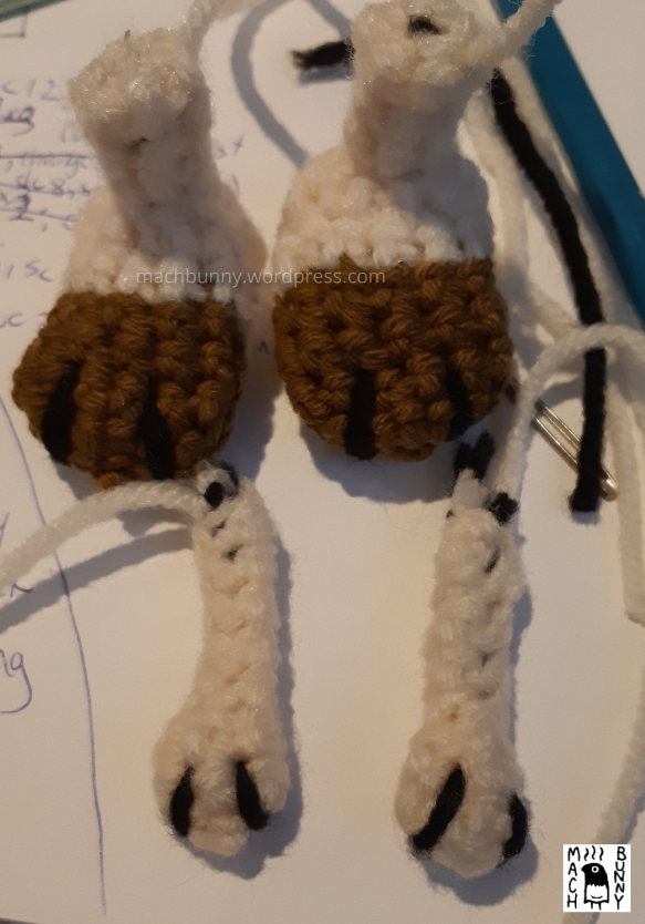 Amigurumi Meowth arm and leg pieces