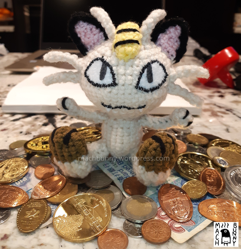 Amigurumi Meowth on coins