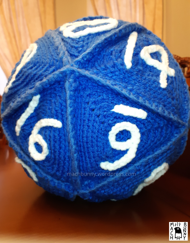 Amigurumi D20, a crocheted 20-sided die