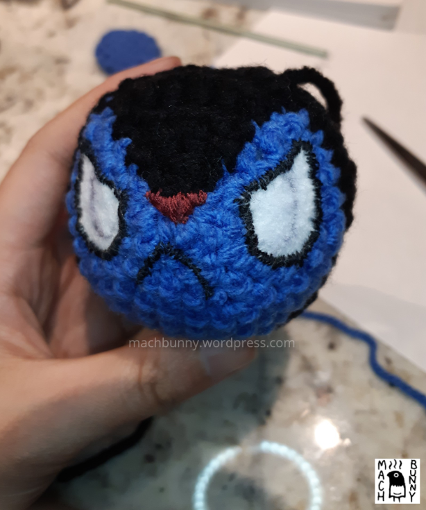 Amigurumi Luxio, with felt eyes, nose and mouth stitched into place