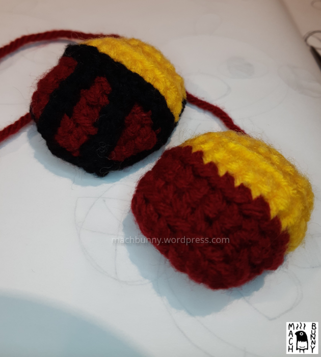Top side of amigurumi natu, with and without stripes