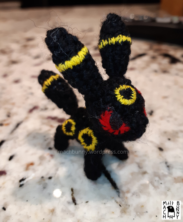 Tiny amigurumi Umbreon, front view