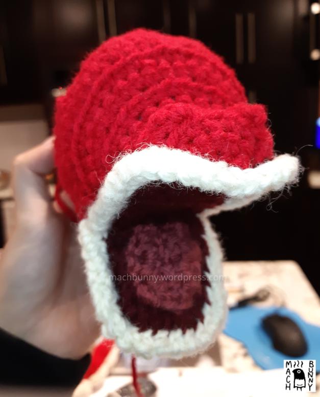 Tiny shiny amigurumi Gyarados, front view of the face with lips and tongue