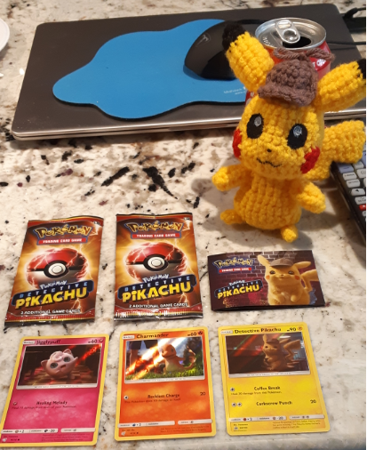 Amigurumi Detective Pikachu, front view with promo cards from the movie