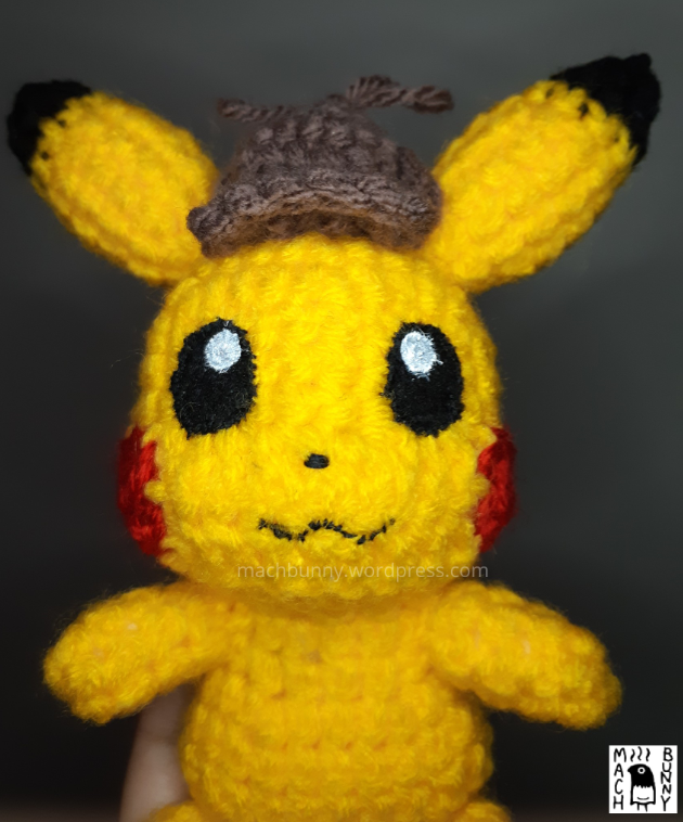 Amigurumi Detective Pikachu, front view close up