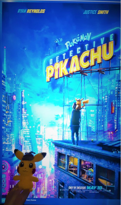 Amigurumi Detective Pikachu, front view with movie poster