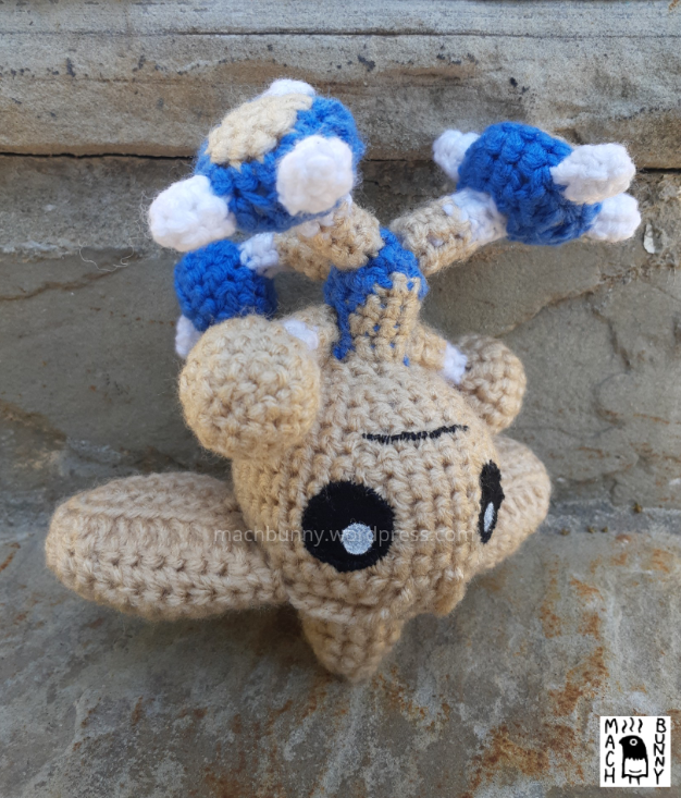 Hitmontop amigurumi, front view and upside down at another angle