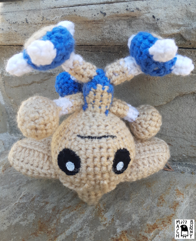 Hitmontop amigurumi, front view and upside down