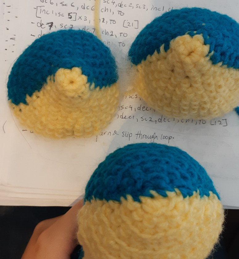 Quilava amigurumi trial pieces and final piece comparison