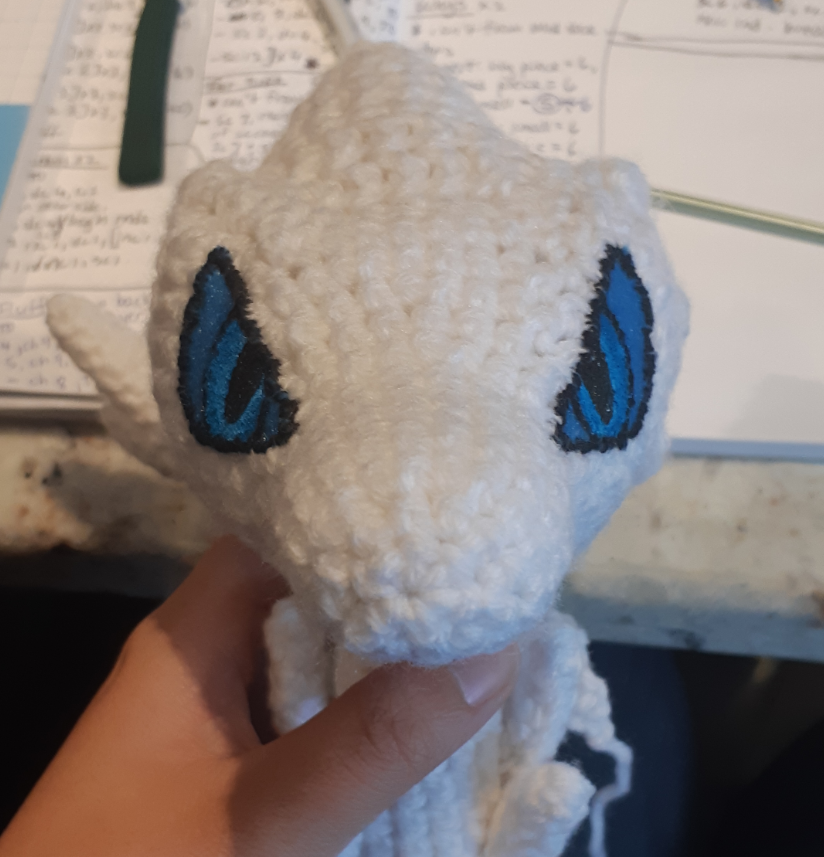 Amigurumi Reshiram, front view of face with eyes stitched on and painted
