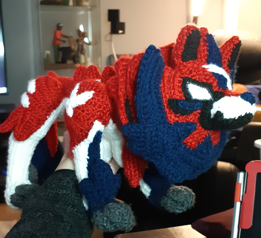 Zamazenta amigurumi with most pieces completed and assembled