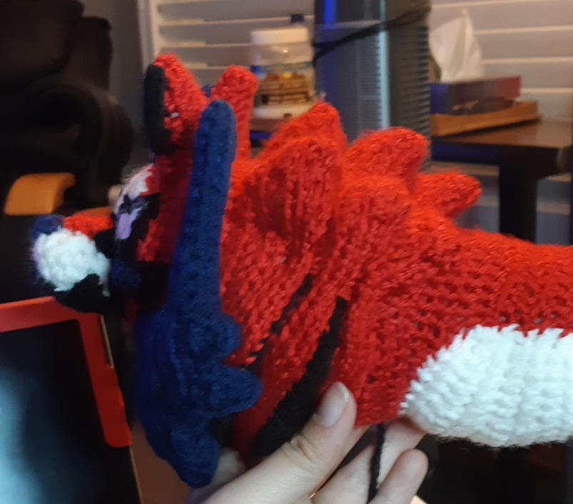 Zamazenta amigurumi with ridges attached and stitched to shape