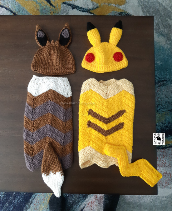 Eevee and Pikachu crocheted hat and blanket sets, featuring ears on the hats, and tails on the blankets.
